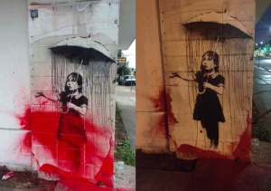 Banksy - Umbrella Girl vandalized